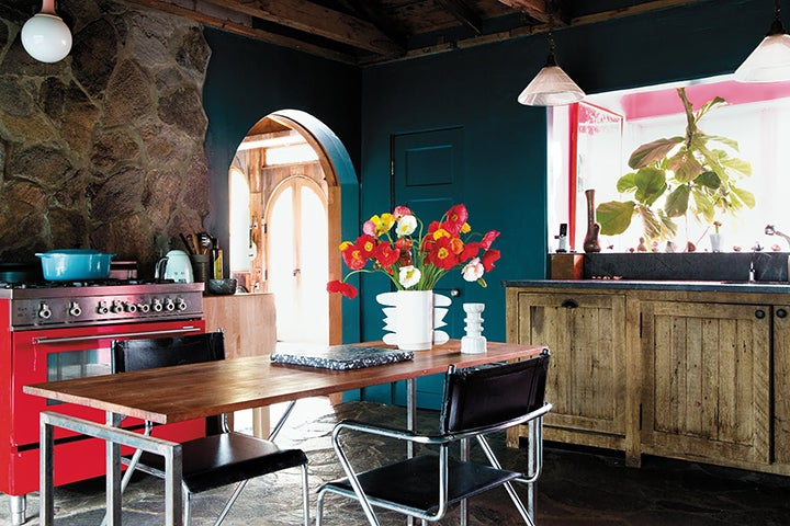 teal kitchen with antique cabinets and red stove