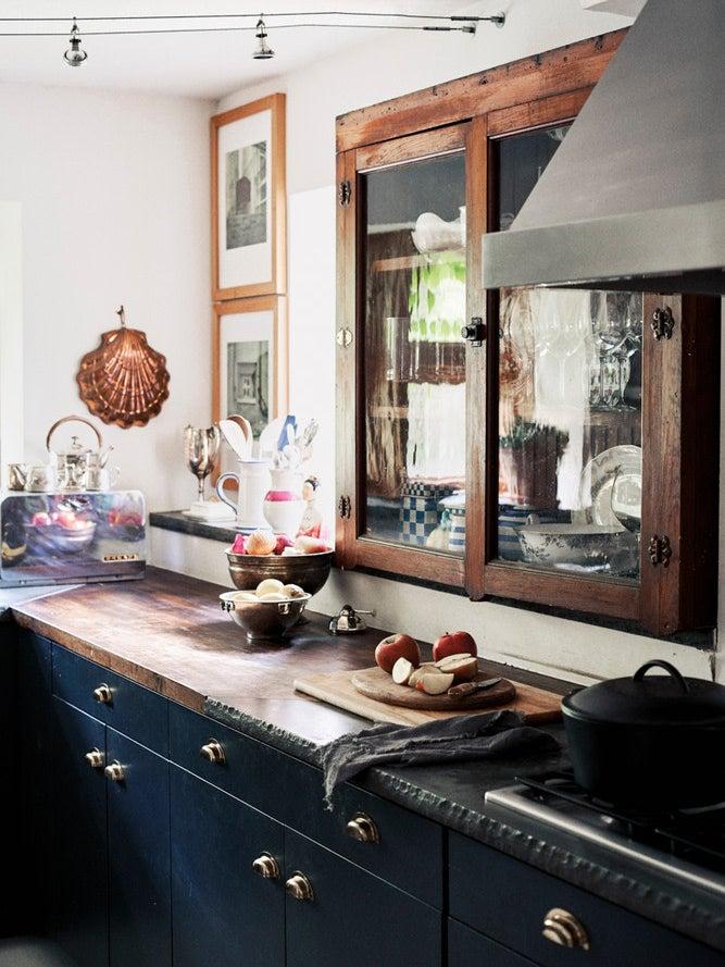 dark blue kitchen cabinets and antique upper cabinet