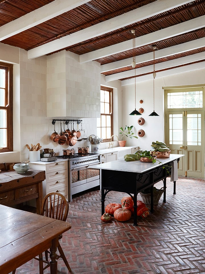 rustic kitchen with wood beams and antique island