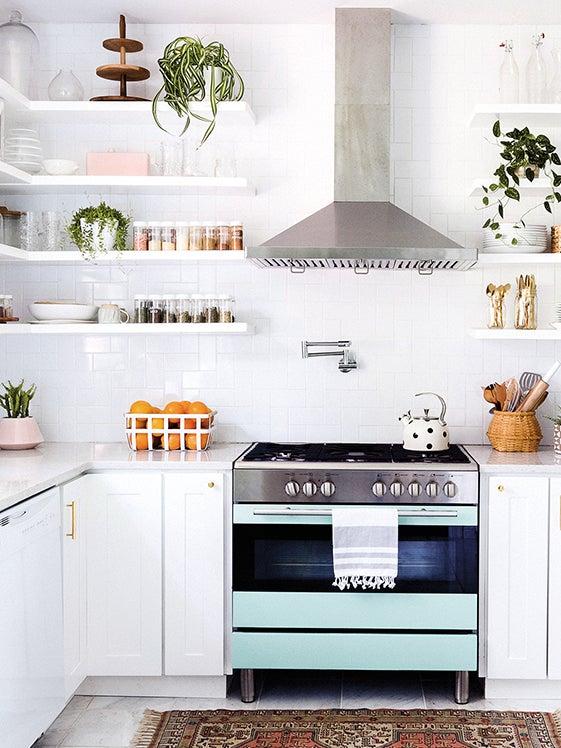 Sleek white kitchen with open shelves