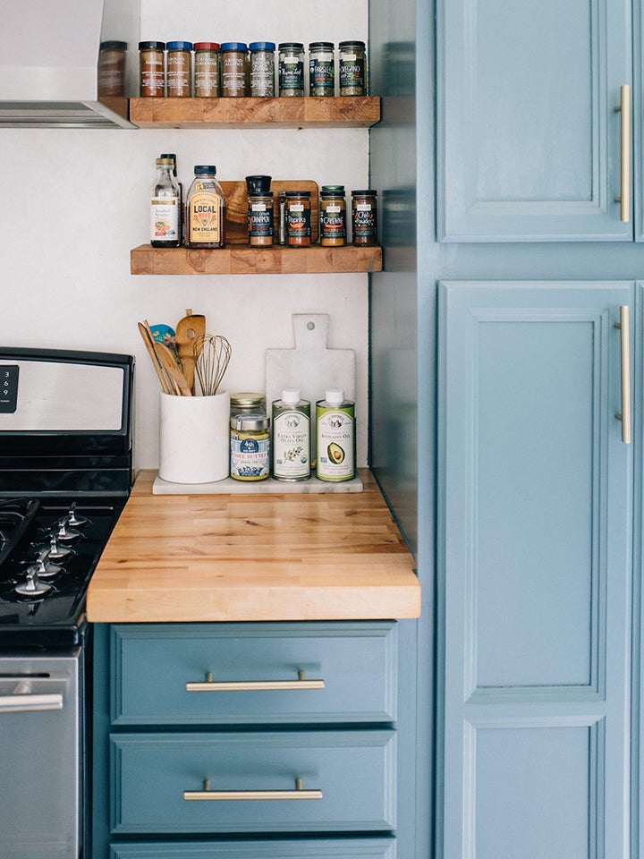 Blue kitchen with two small spice shelves