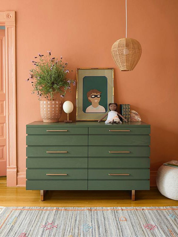 green dresser in front of coral walls