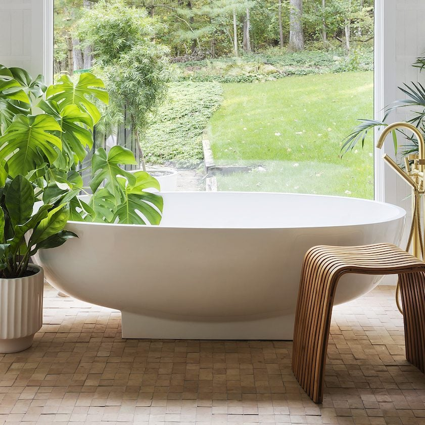 tub surrounded by plants