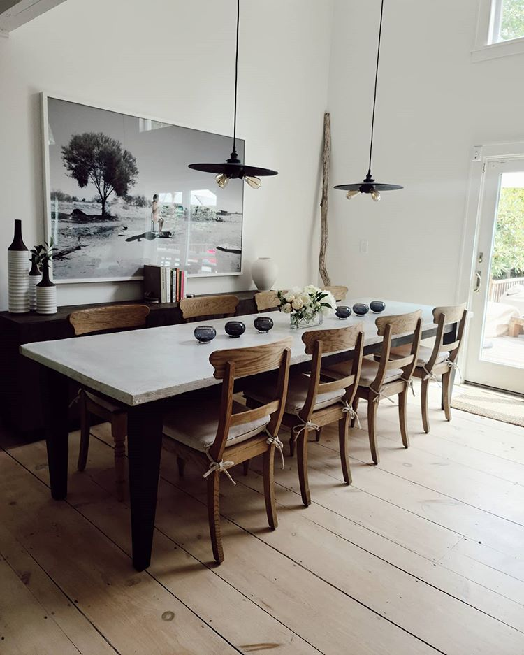 concrete dining room table with matte black pendants