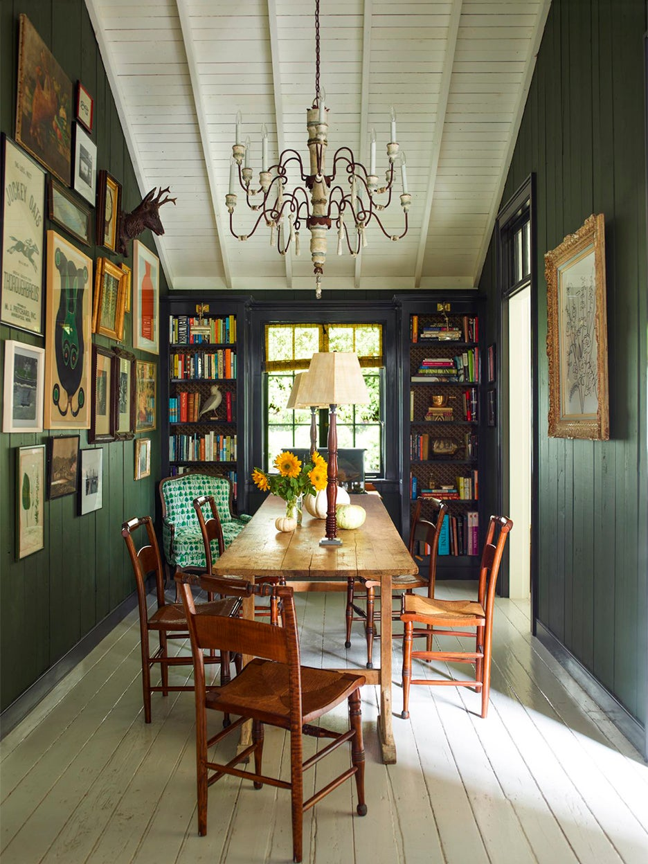 Dark green dining room with paneled walls