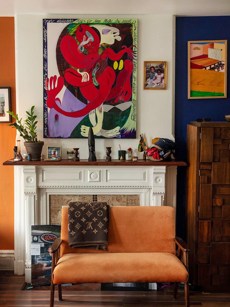 Orange sofa in front of mantel