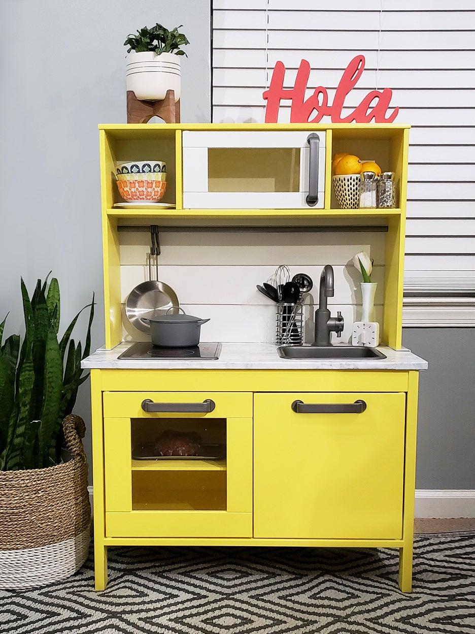 Yellow play kitchen