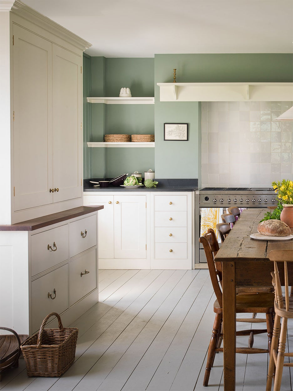 white shaker kitchen cabinets with green painted walls