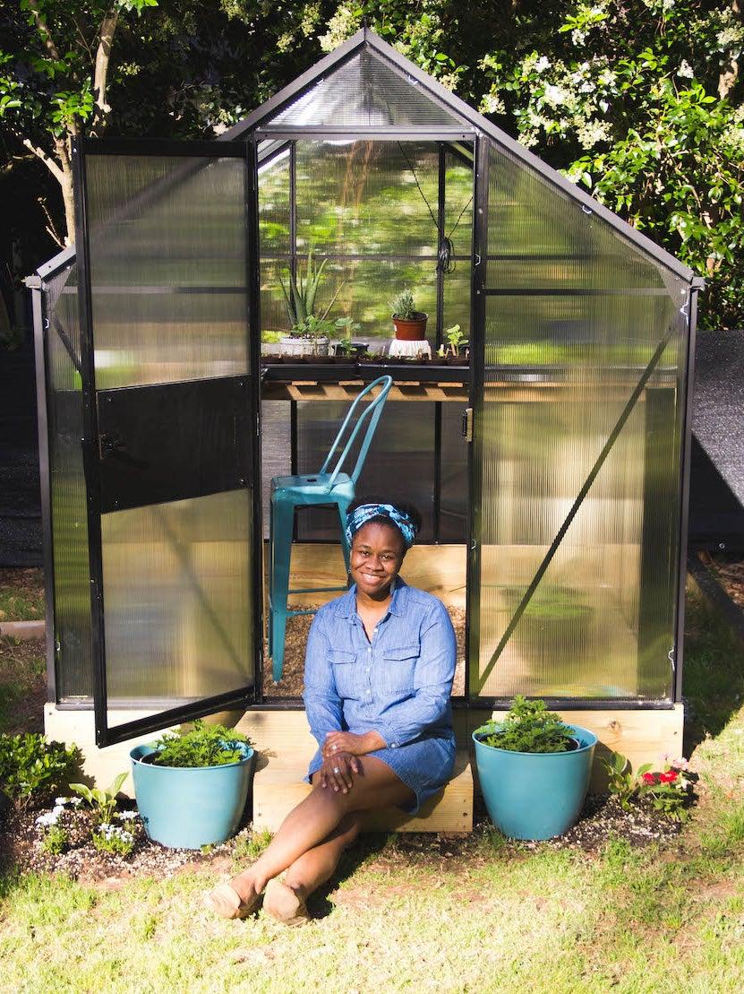 woman sitting in greenhouse door