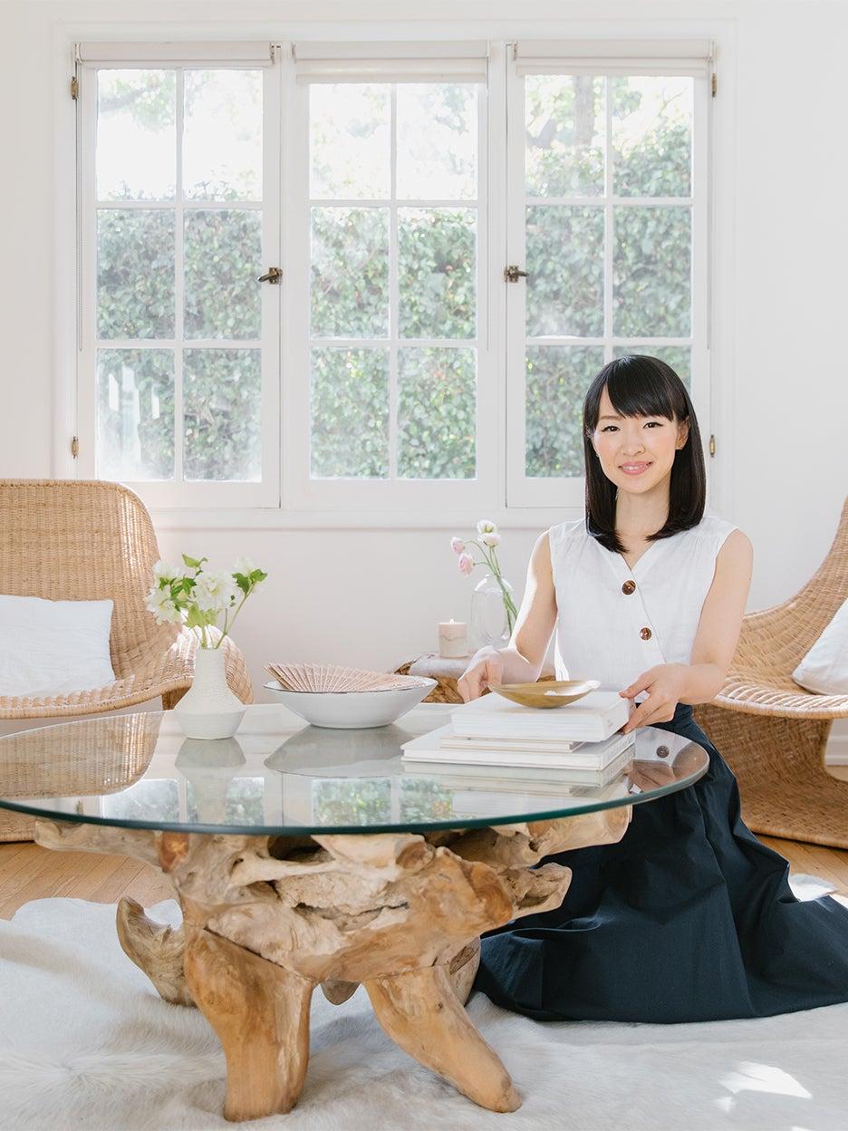 marie kondo sitting in living room