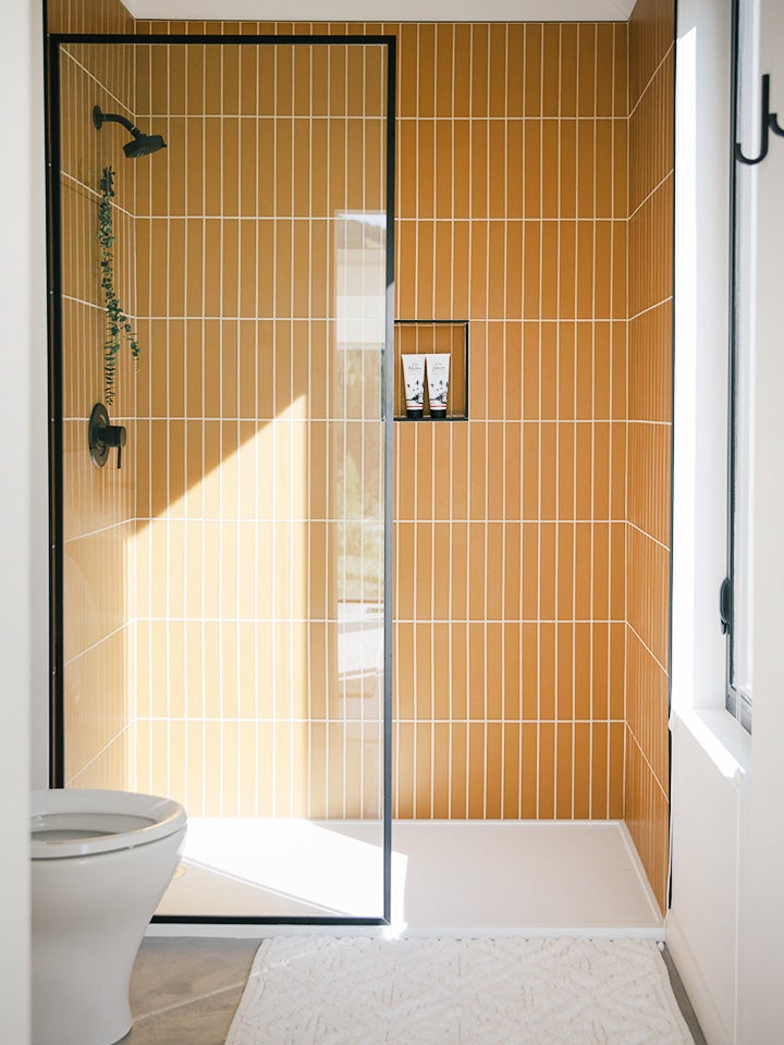 yellow glass tile shower nook
