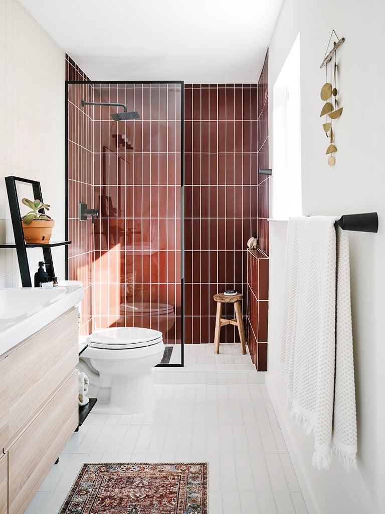 red glass subway tile shower in white bathroom