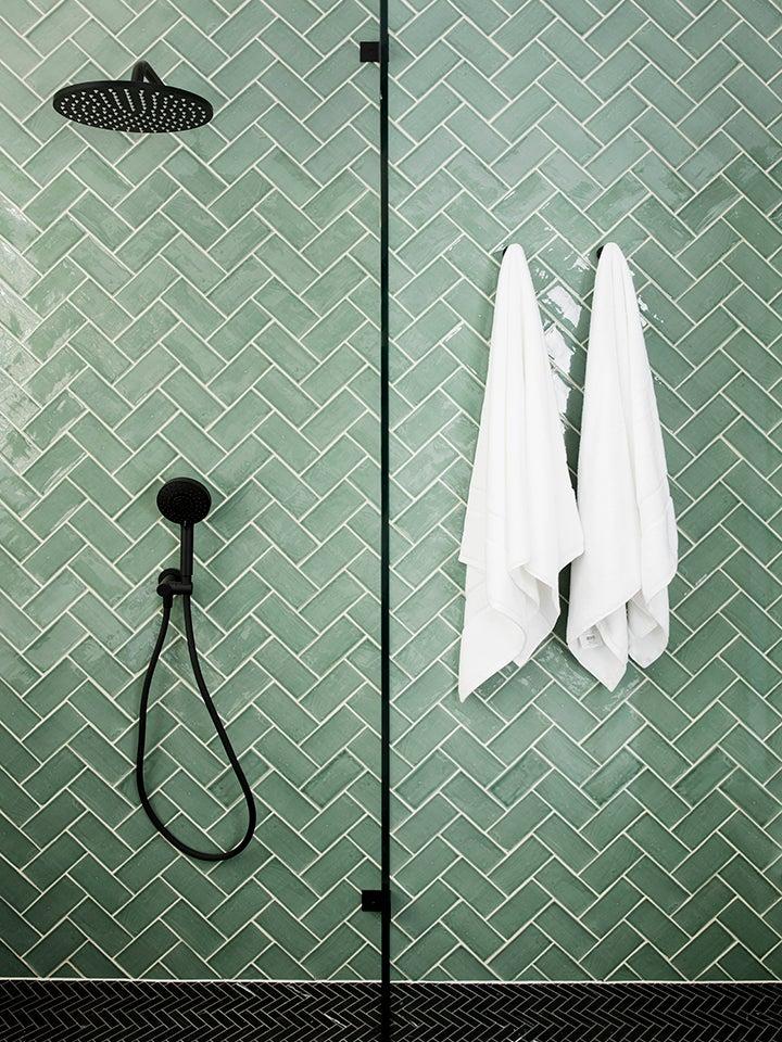 seafoam green subway tile shower