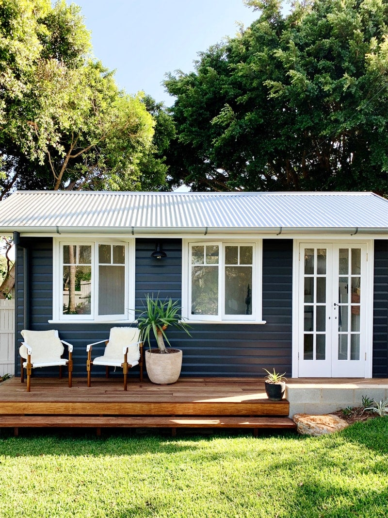 Exterior of blue backyard shed