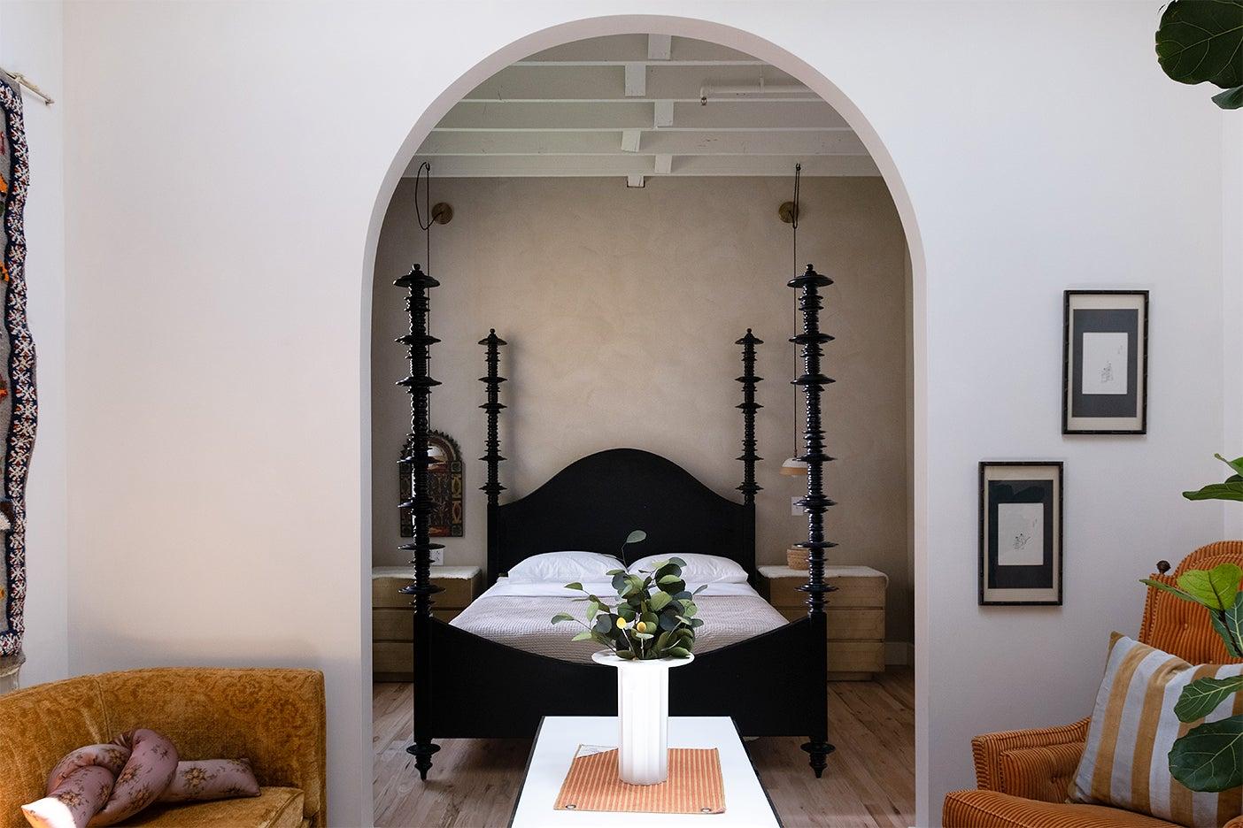 bedroom behind arch doorway