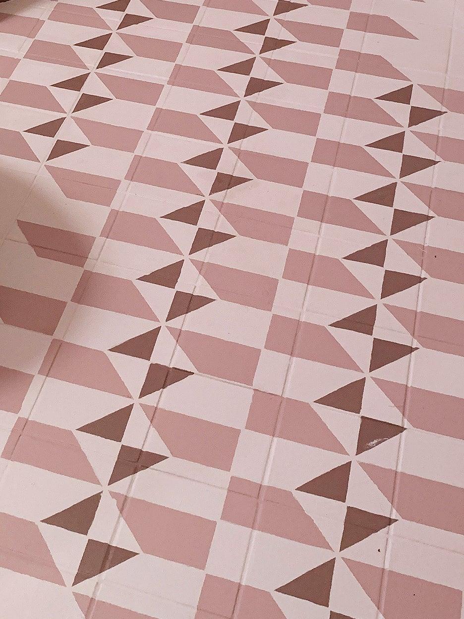 pink stenciled painted floor tile
