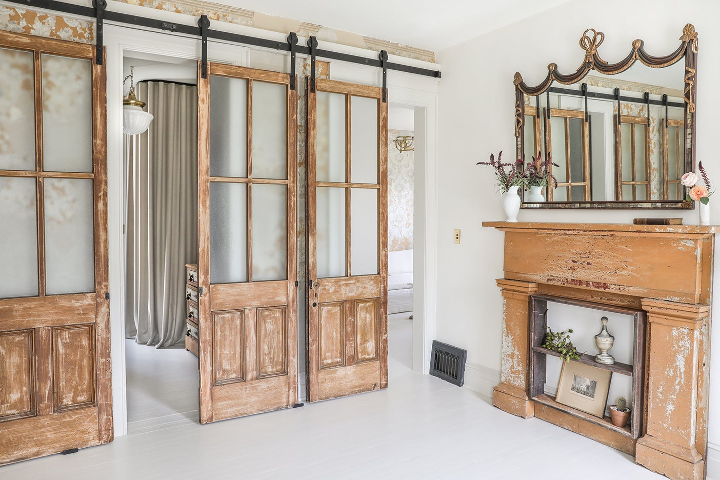 room with sliding barn doors and matching mantel