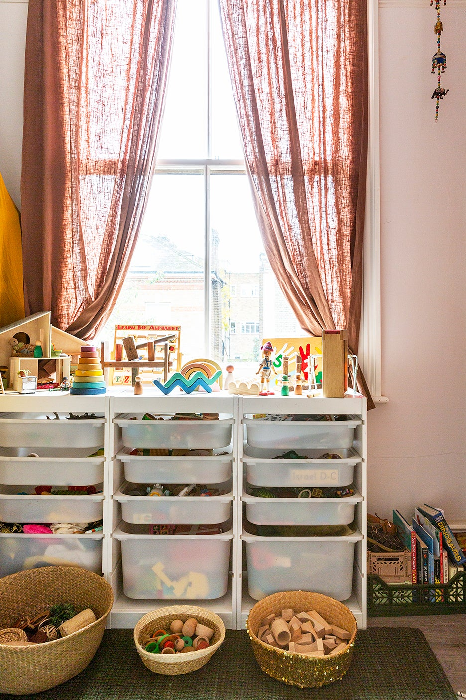 storage unit topped with toys