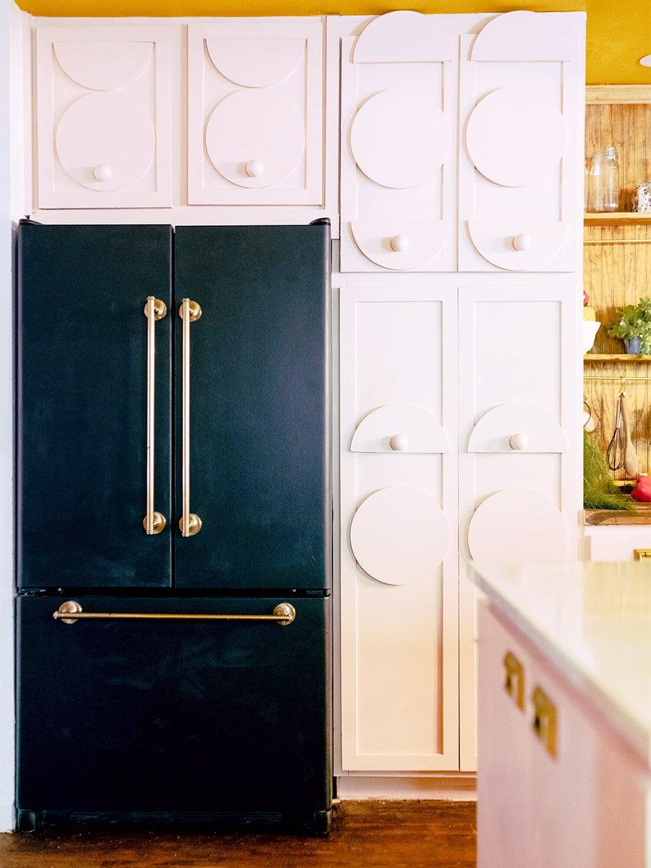 black fridge with white cabinets