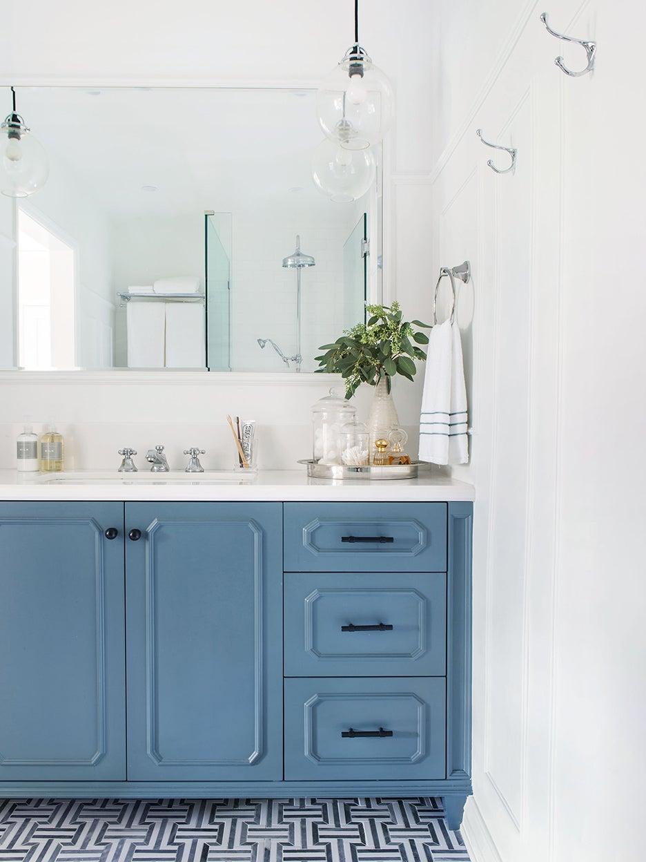 white bathroom with light blue sink unit