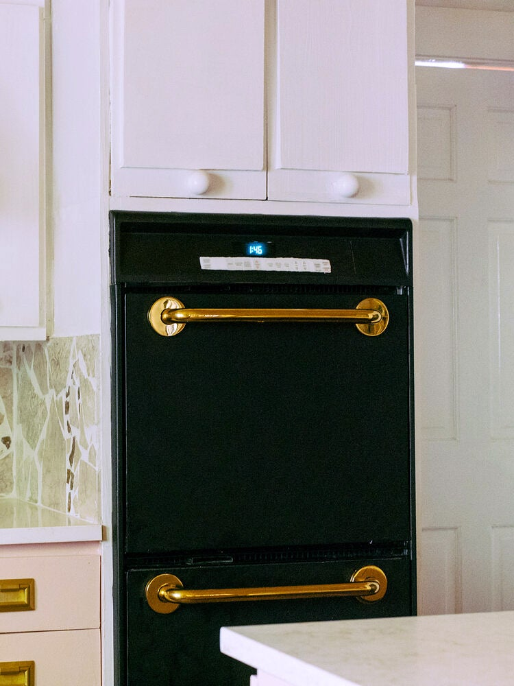 black oven with brass bars