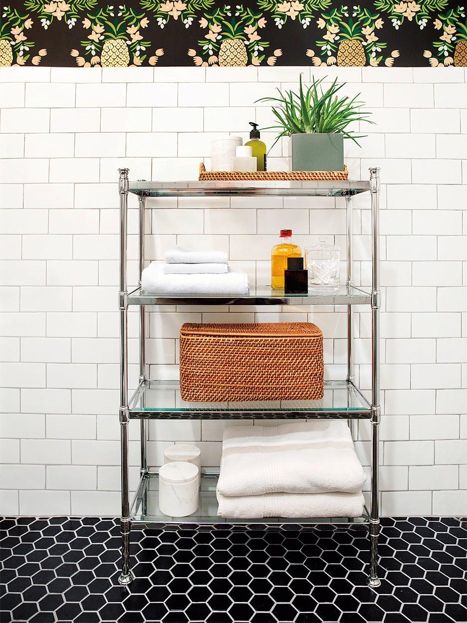 black tile floor white subway tile wall bathroom with chrome cart