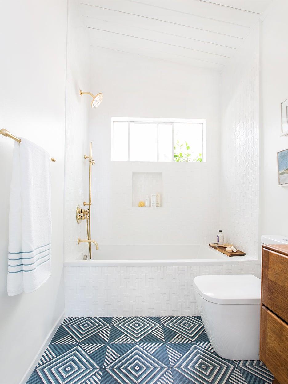 white bathroom with blue retro graphic floor tile