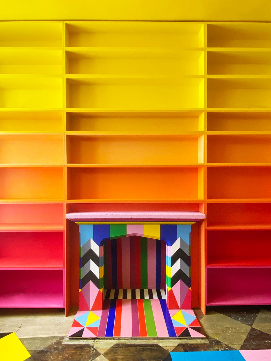 ombre bookshelf with painted and tile fireplace