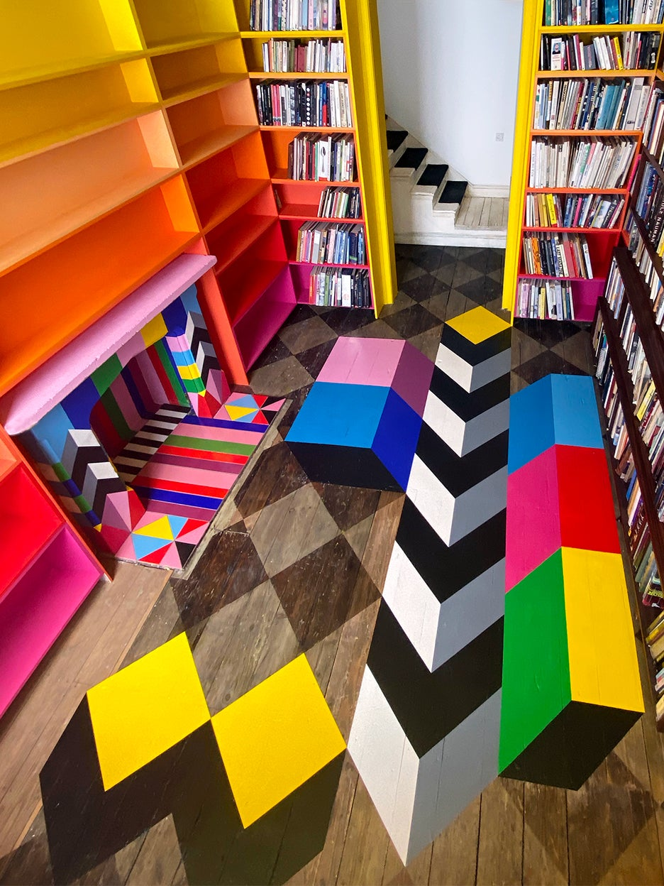 room with checkerboard floors that have a colorful mural painted over them