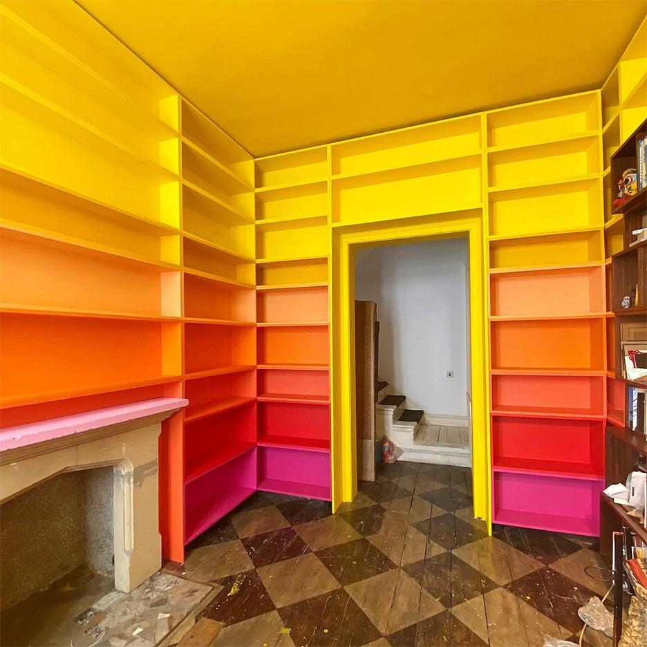 orange, yellow, pink ombre bookcases