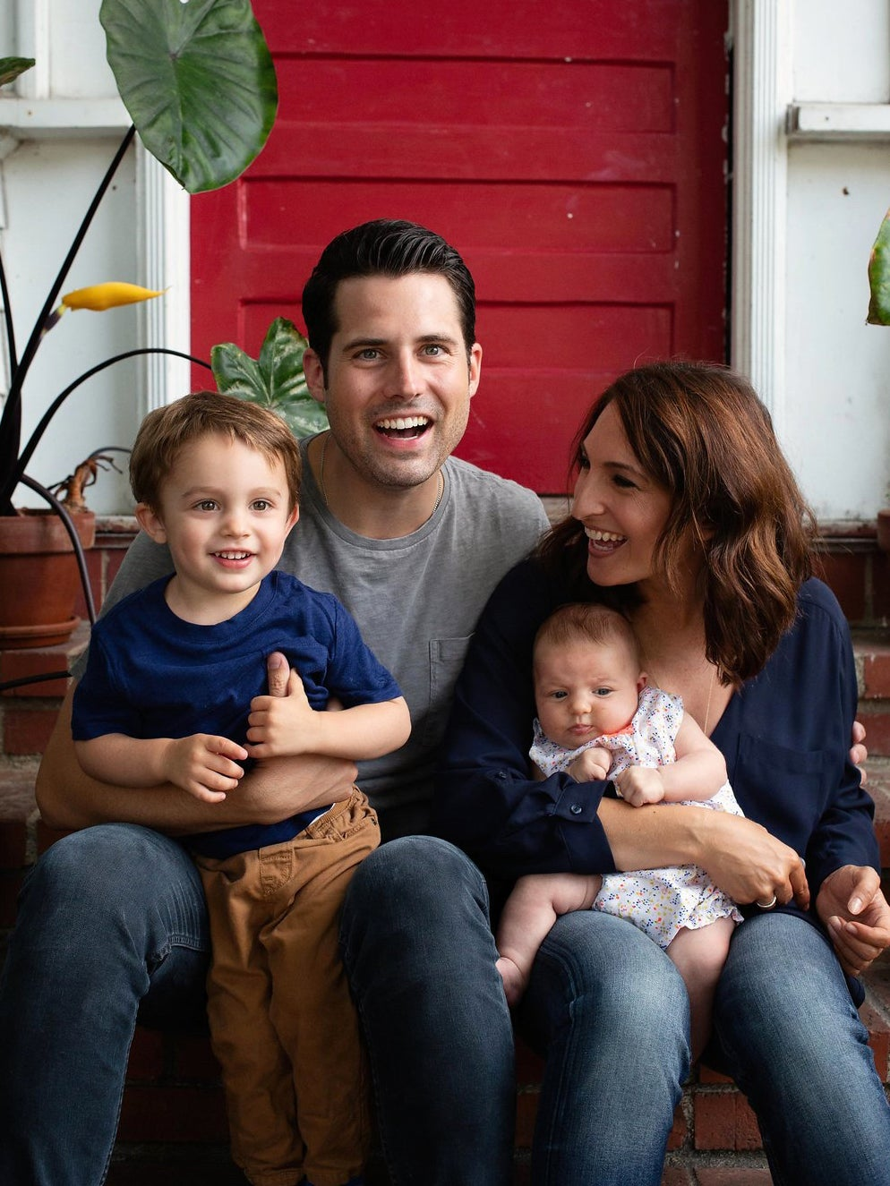 Natalie and Chris Bruss at home with their kids