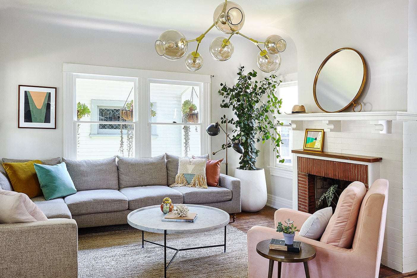Living room with gray sofa and pink chair