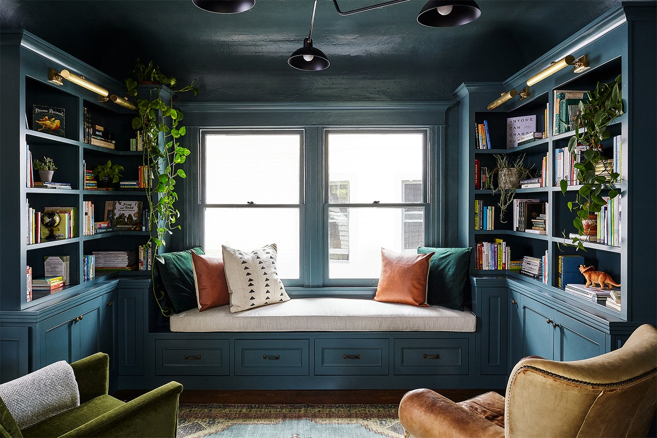 Library room with teal walls