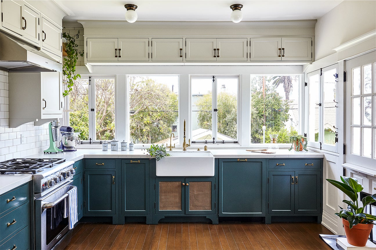 Traditional kitchen with navy lower cabinets