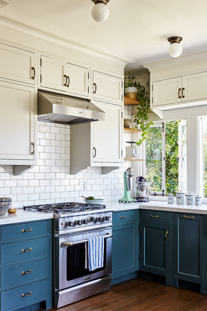 Traditional kitchen with blue lower cabinets