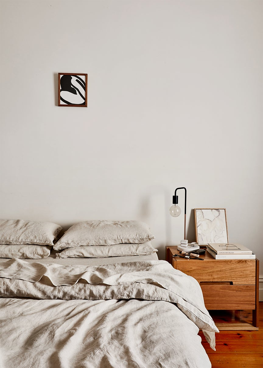 bedroom with bed with gray duvet