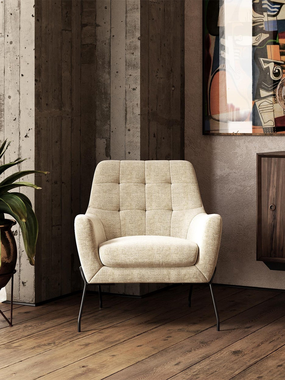 cream colored armchair in living room