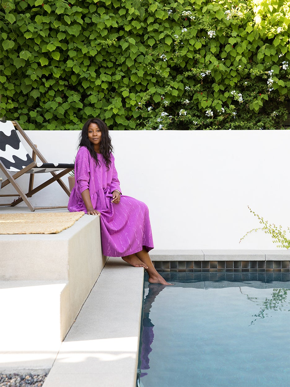 camilla Blackett sitting by pool