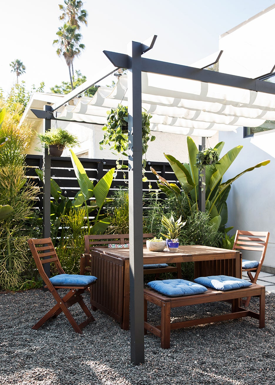 outdoor dining area with wooden furniture