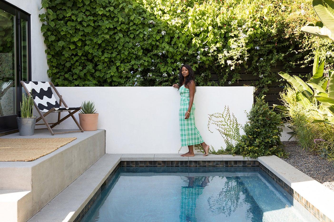 camilla Blackett walking by pool