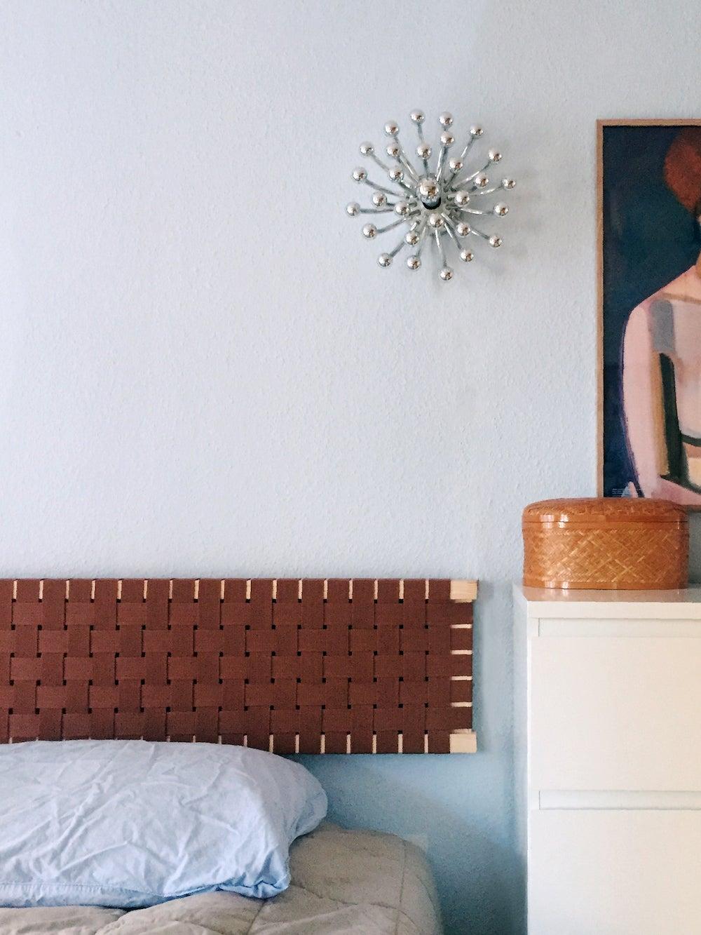 cane headboard in blue bedroom