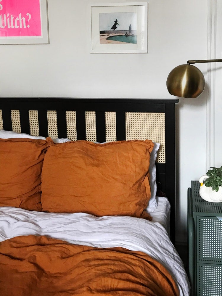 ikea bed frame with rust orange bedding