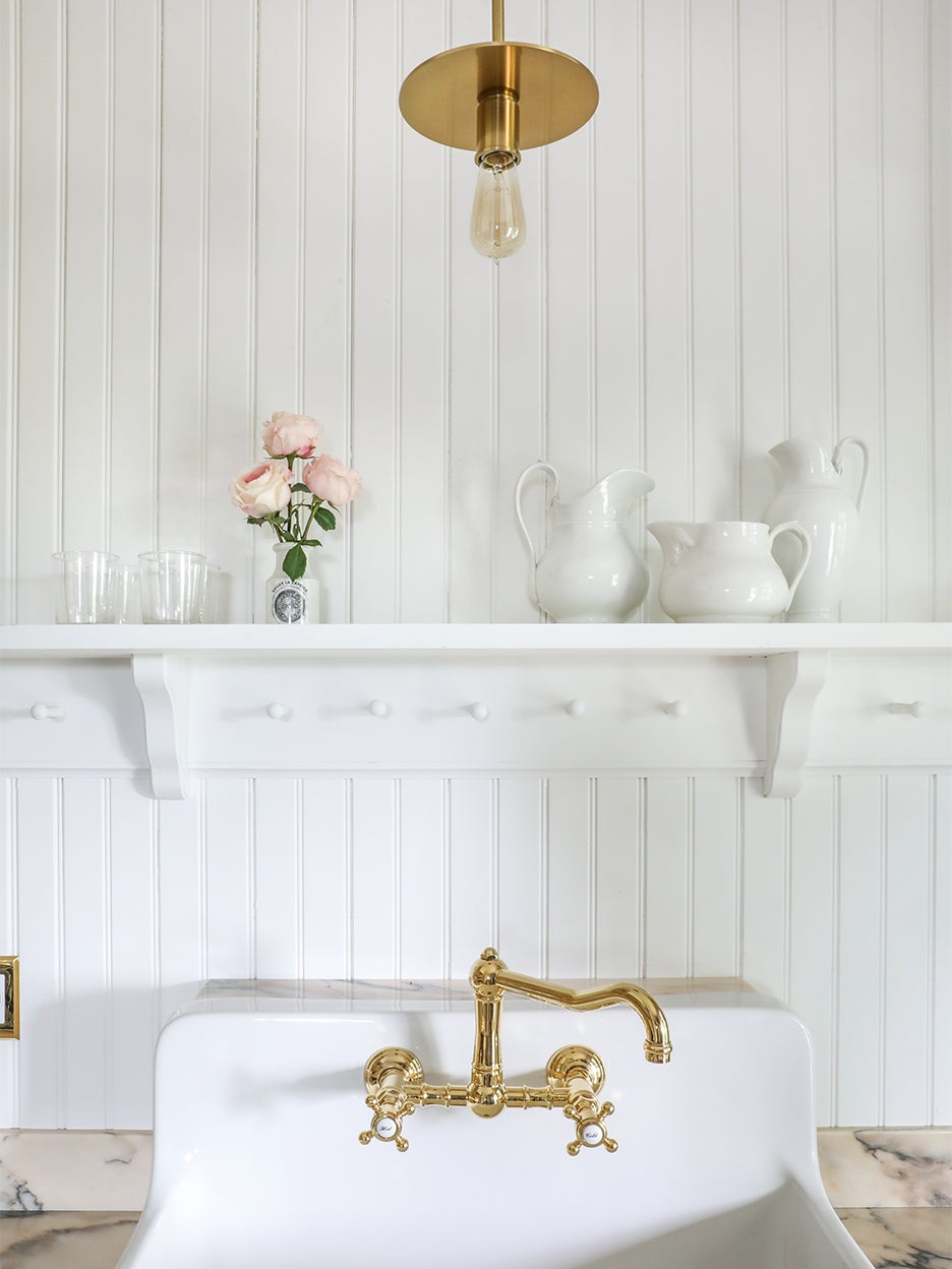 white shiplap wall with shaker pegboard