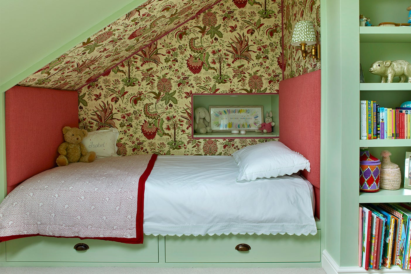 Kids built-in bed nook with floral fabric walls