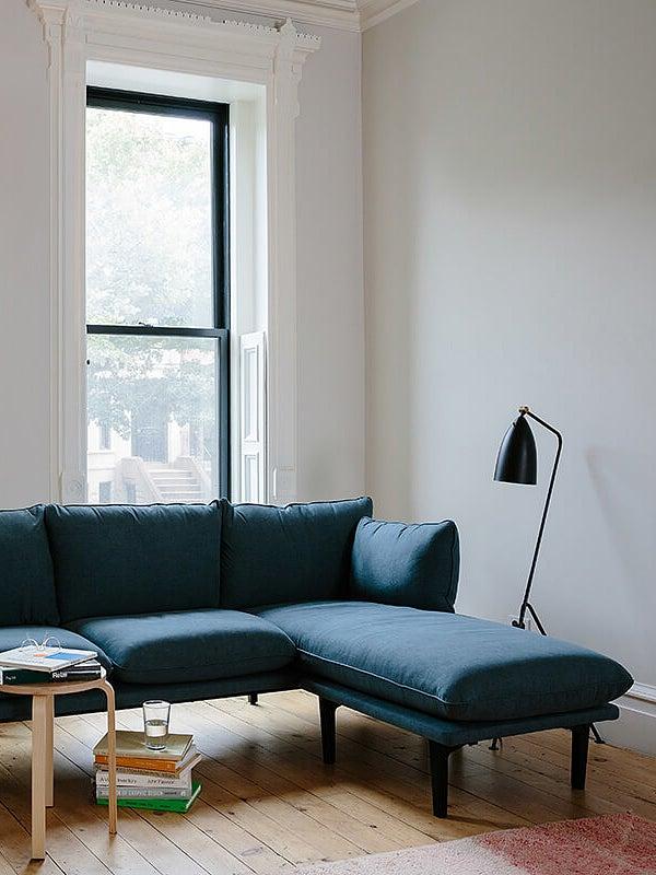 blue sofa in white living room