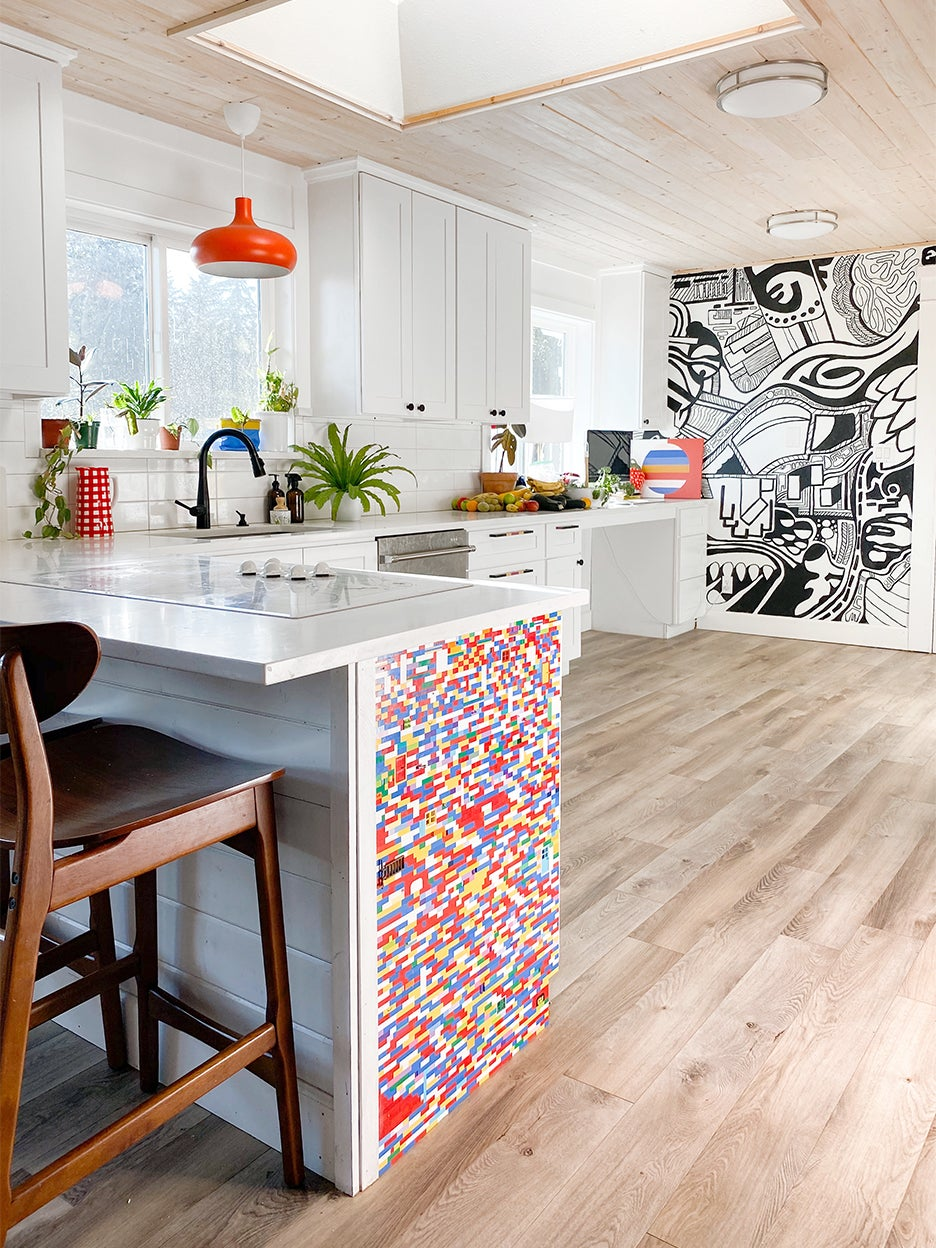 white kitchen with colorful peninsula