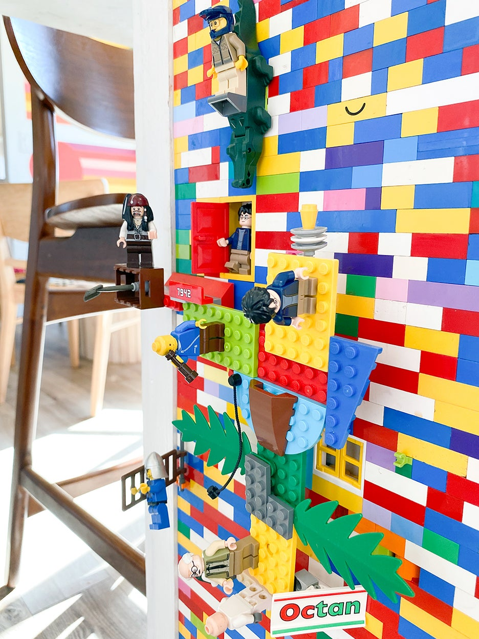LEGO people stuck to wall