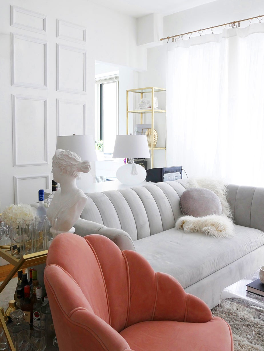 chic living room with pink chair and gray sofa