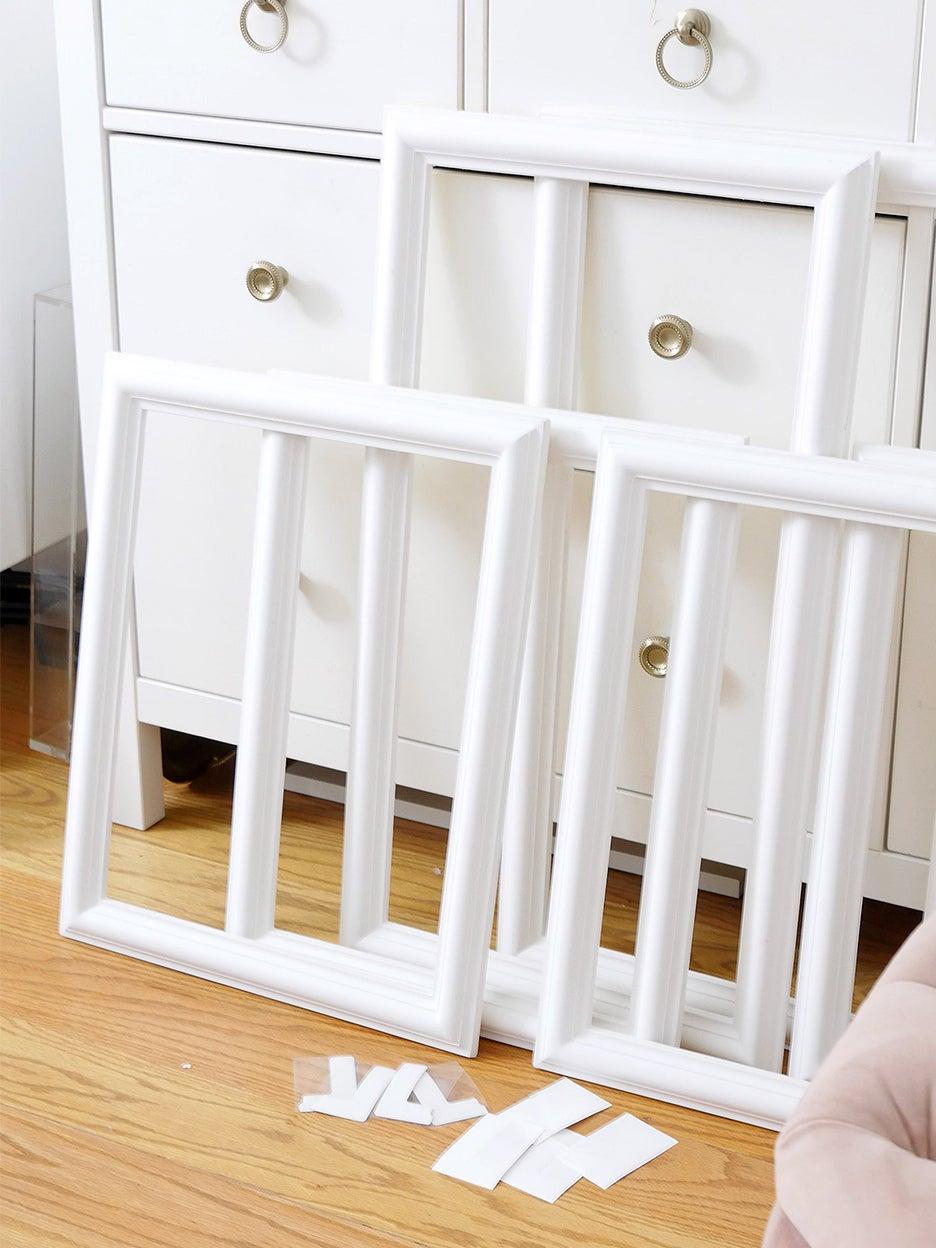 wood panels leaning up on dresser