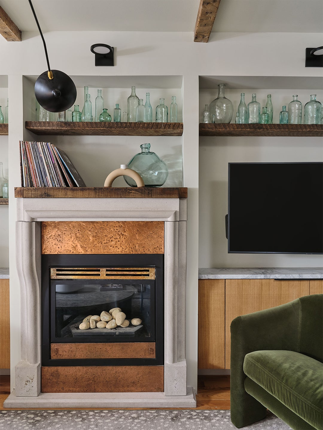cozy living room wall lined with glass bottles
